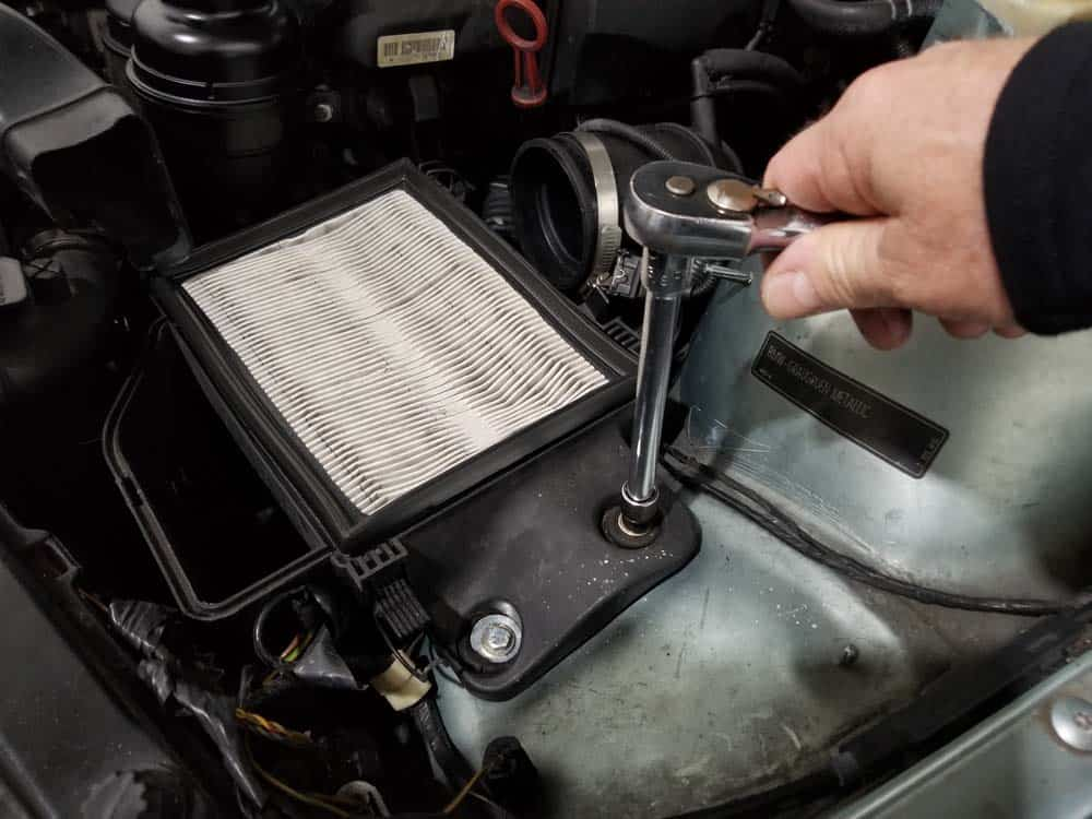 BMW E46 radiator - remove the two intake muffler mounting bolts