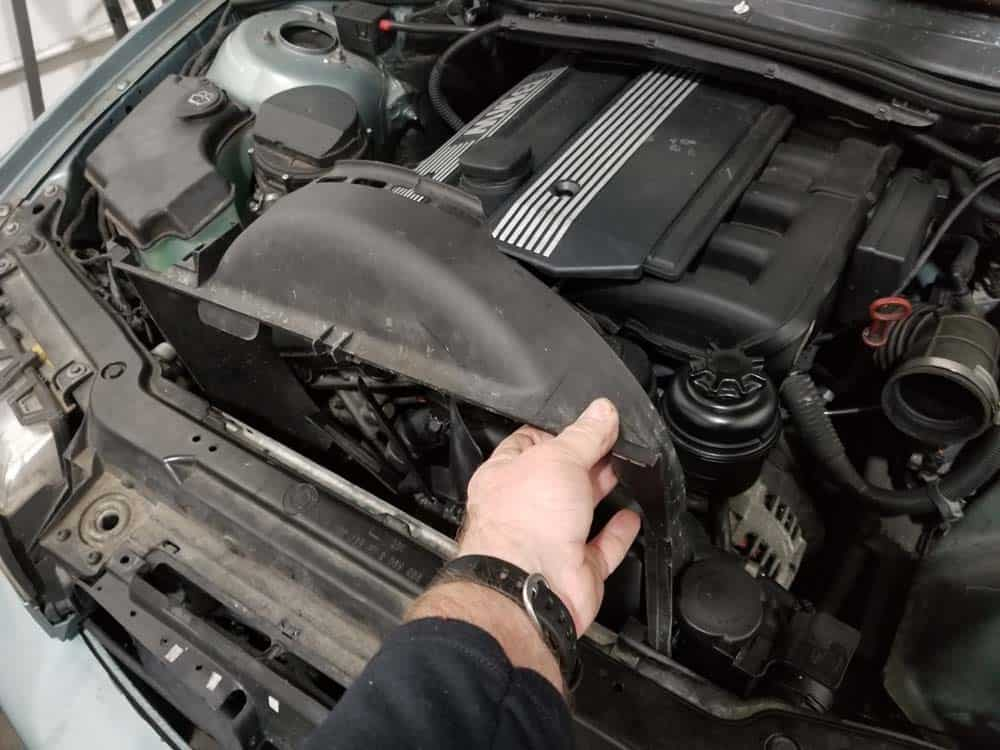 Remove the fan shroud from the engine if the clutch nut is frozen.