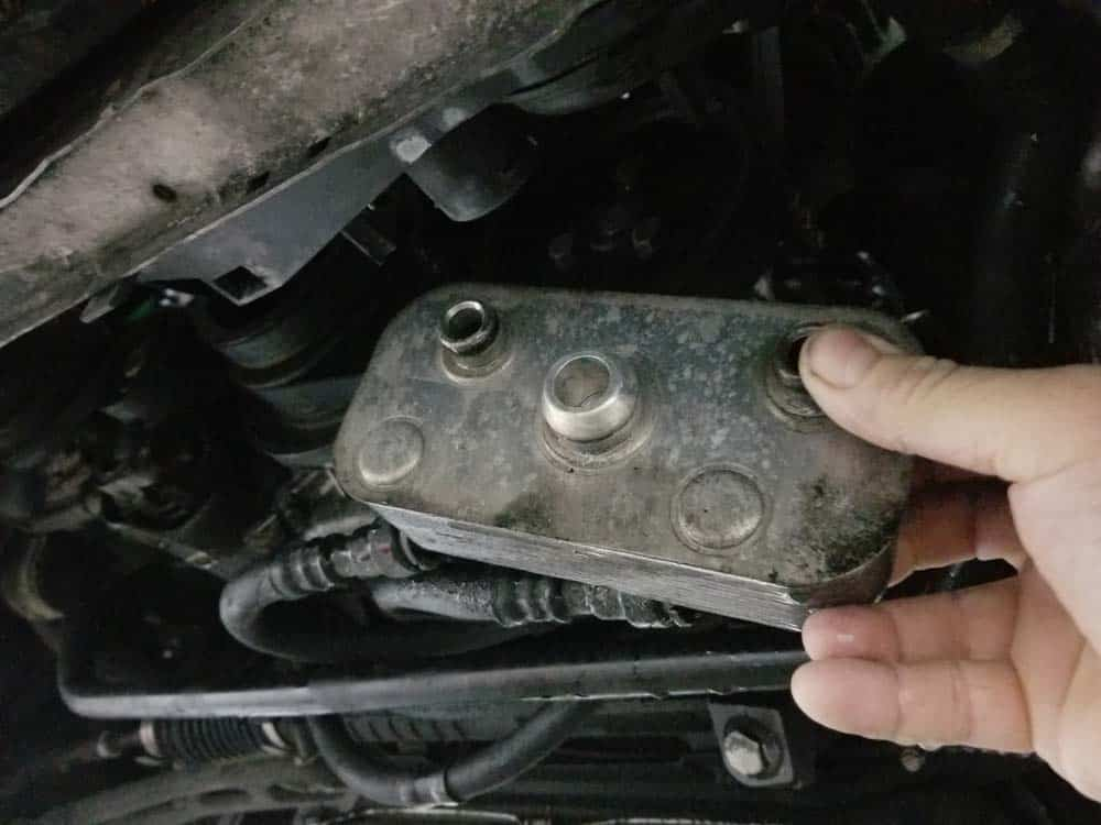 bmw e46 radiator - remove the transmission cooler from the radiator.