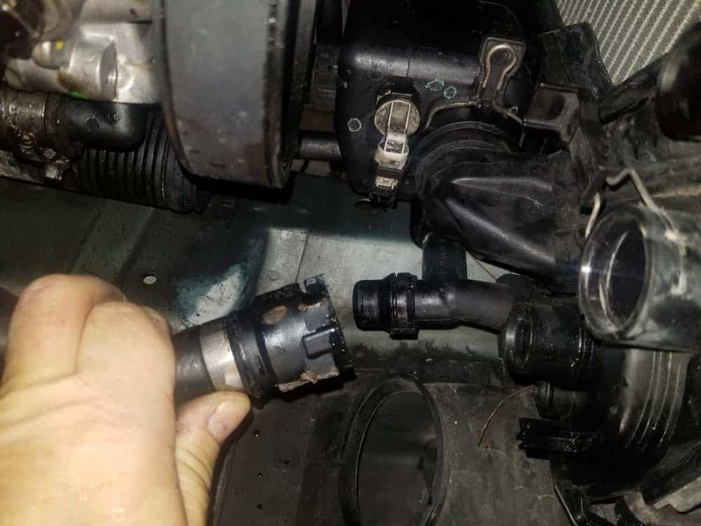 bmw e46 radiator - remove the left lower radiator hose.