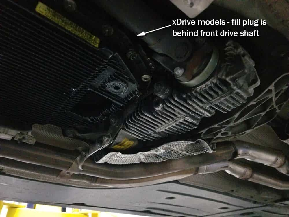 BMW Mechatronics Sealing Sleeve and Adapter Replacement - locate the fill plug at the top rear right of the transmission