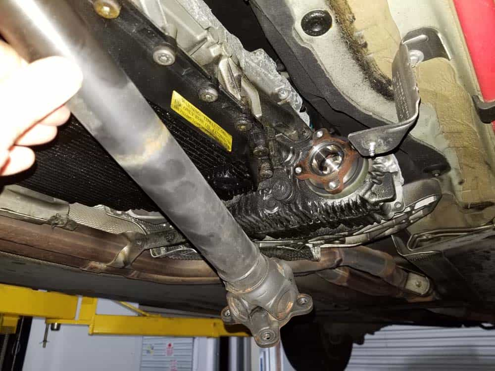 BMW Mechatronics Sealing Sleeve and Adapter Replacement - Unbolt and lower the front driveshaft