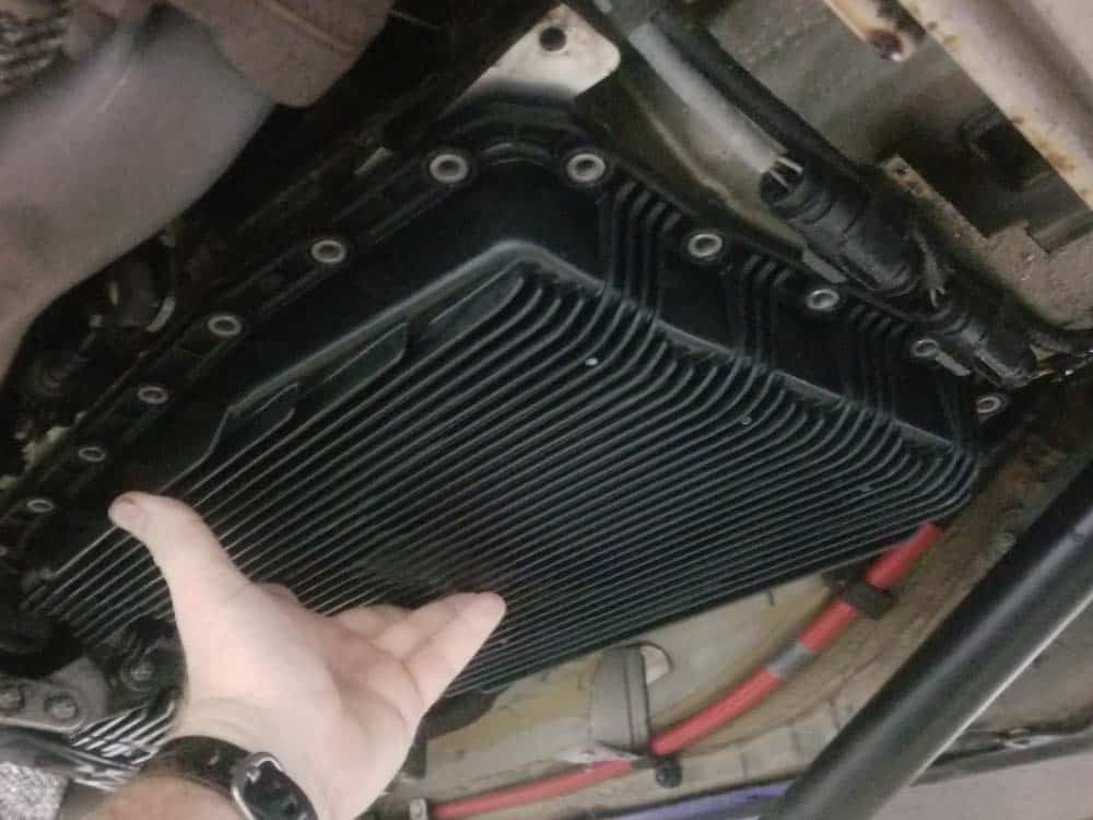 BMW mechatronics sealing sleeve and adapter replacement - Lift the oil pan into position