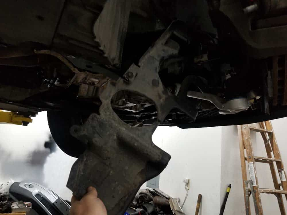 bmw e60 front axle shaft - Remove the splash guard from the vehicle.