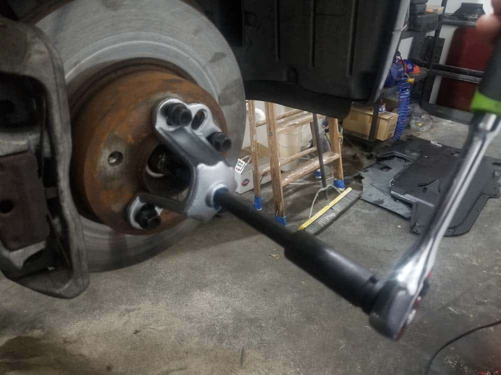 bmw e60 front axle shaft - Tighten the hub puller and slowly push the drive axle out of the hub.