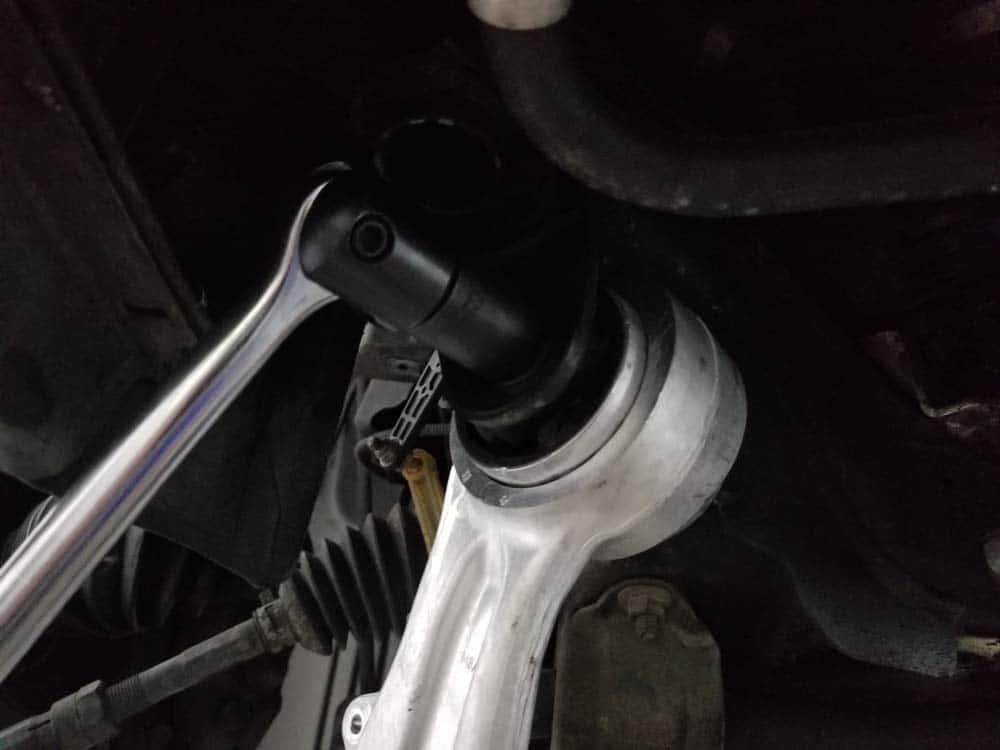 bmw e60 front axle shaft - Loosen the upper control arm bushing bolt