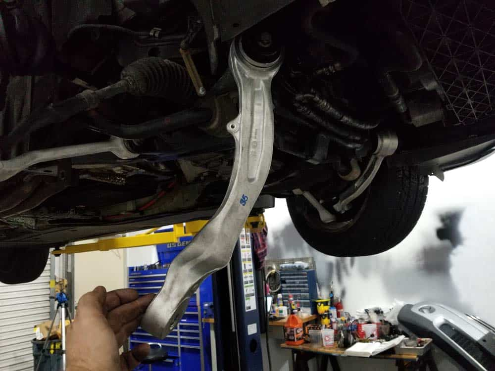 bmw e60 front axle shaft - Swing the upper control arm down and out of the way.