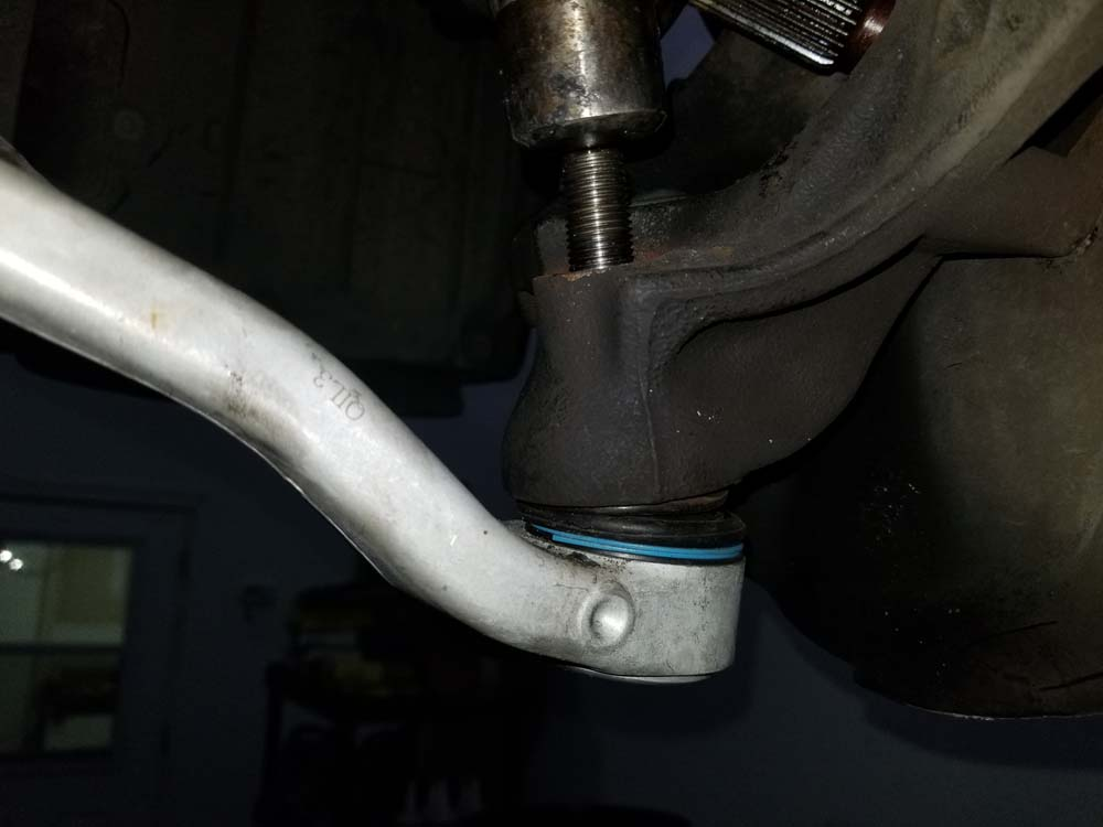 Use a hammer to knock the lower control arm ball joint out of the steering knuckle.