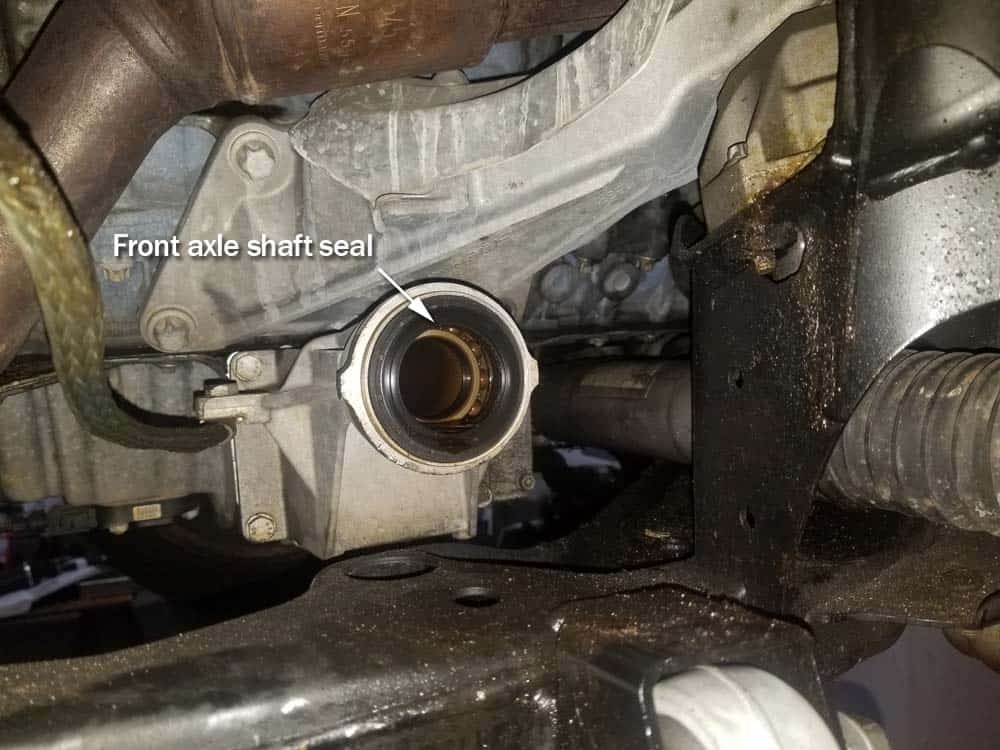bmw e60 front axle shaft - Locate the front axle shaft seal inside the differential