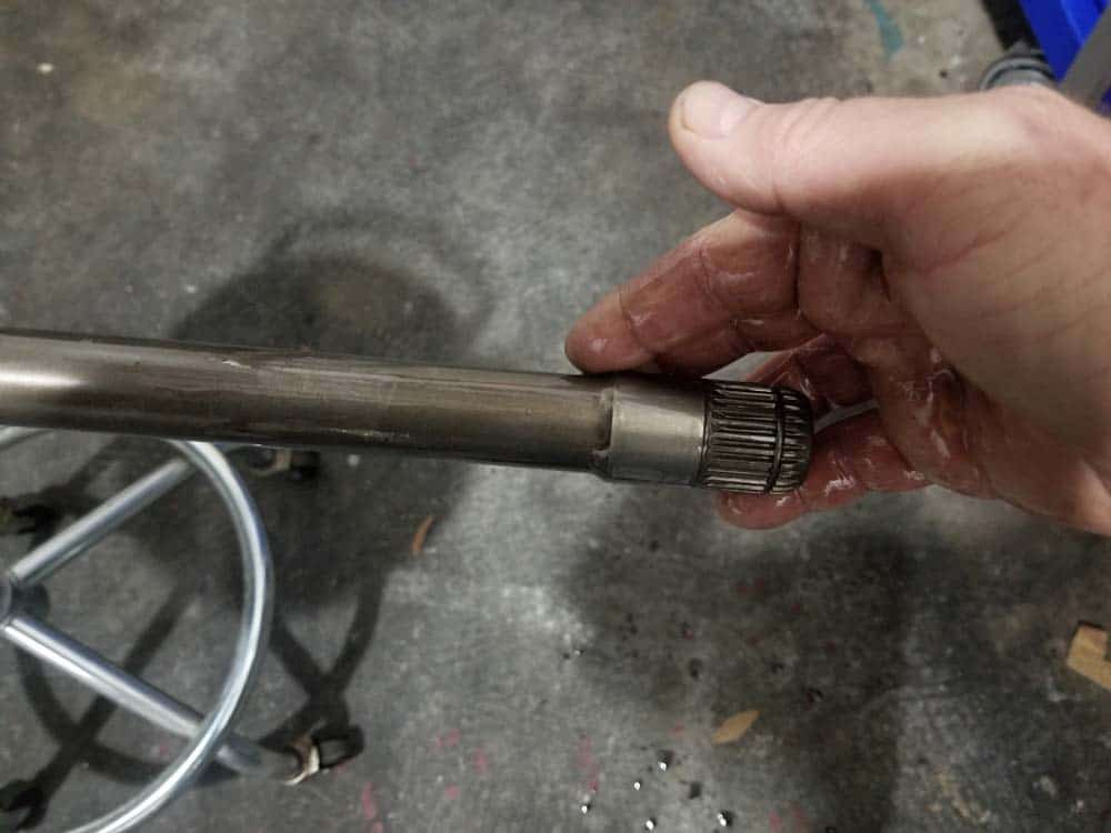 bmw e60 front axle shaft - Liberally apply lubricant to the axle shaft.