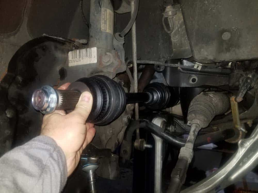Install the new axle shaft into the differential.
