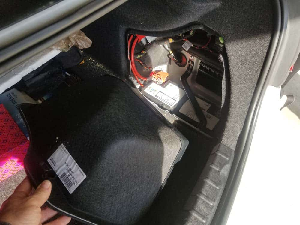 BMW F30 battery replacement - Remove the storage tray from the car.