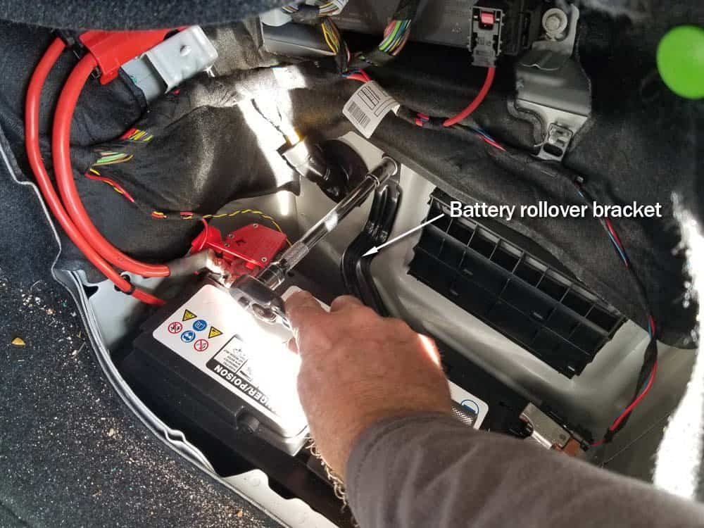 BMW F30 battery replacement - Remove the battery rollover bracket from battery compartment.