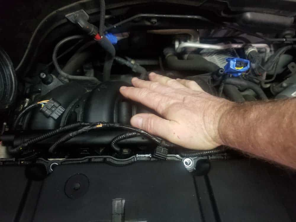 MINI R56 intake gasket repair - Use the palm of your hand to seat the injectors in the cylinders.