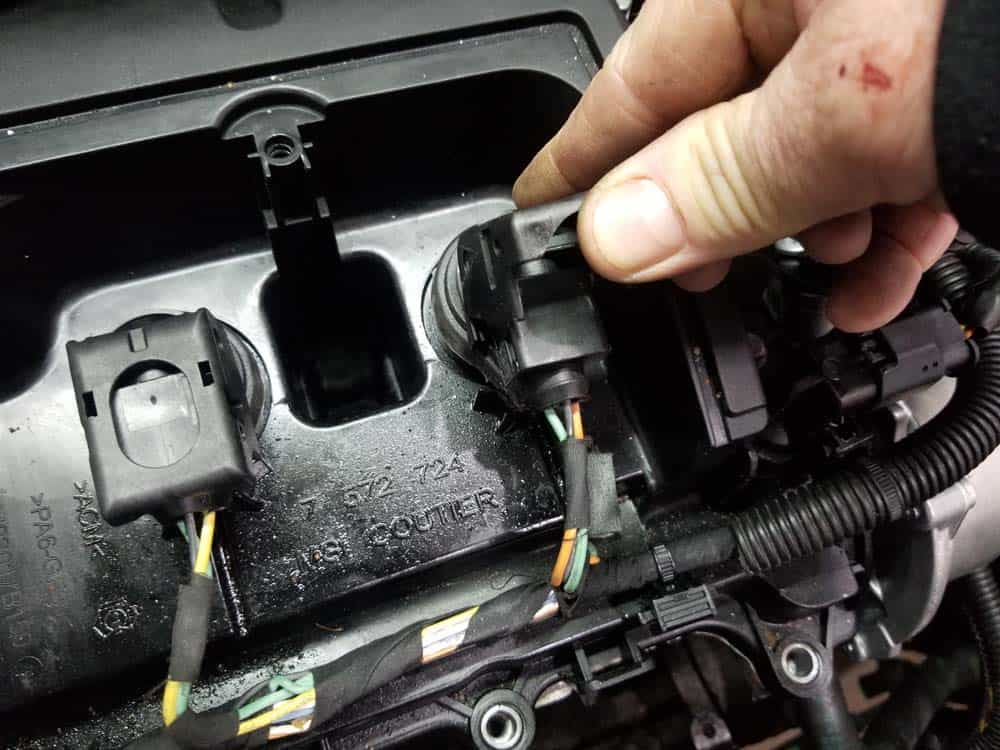 MINI R56 Tune Up - Flip up the plastic locking mechanism on the coil.