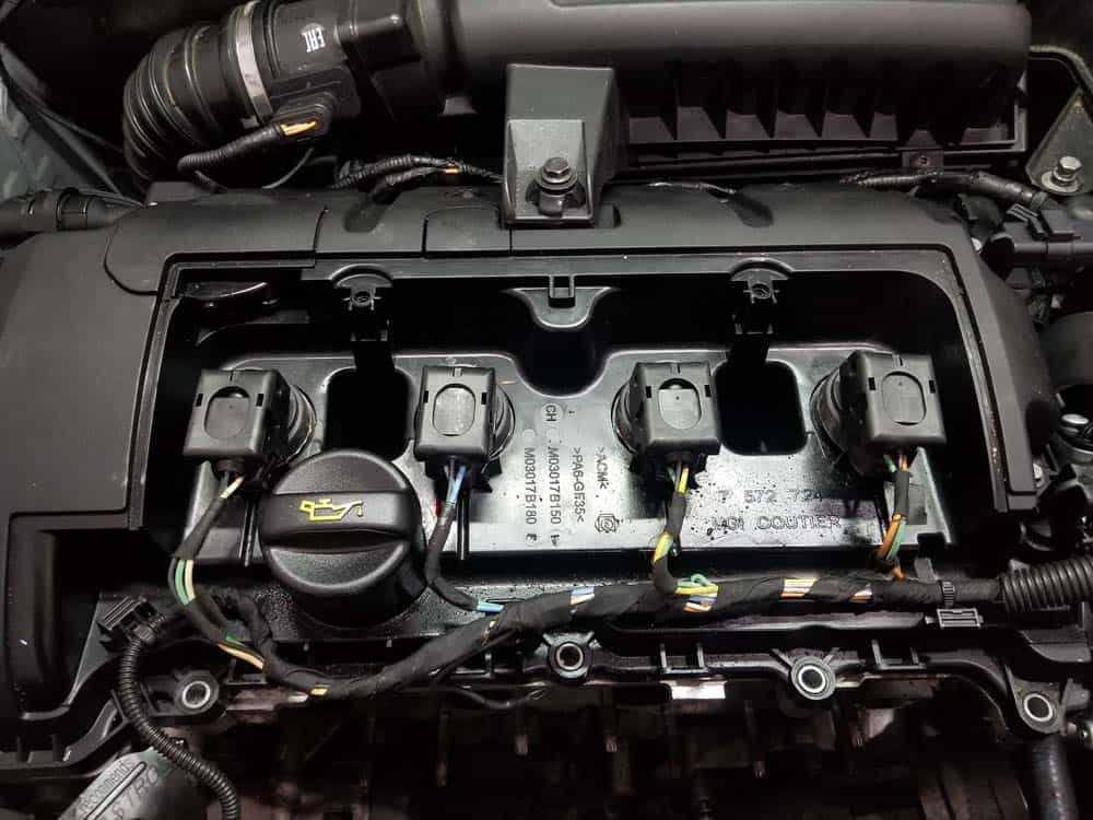 Locate the four ignition coils inside engine compartment.
