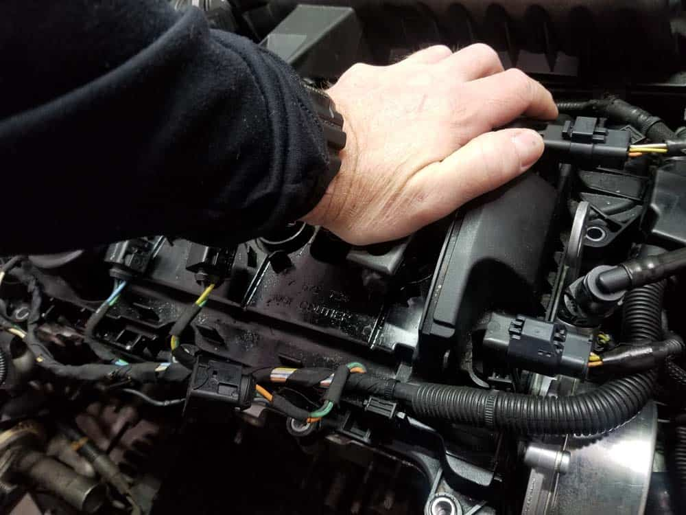 MINI R56 Tune Up - Press the ignition coils onto the spark plugs with the palm of your hand.
