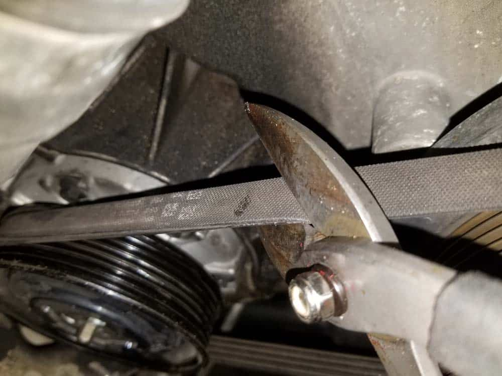 BMW N62 AC Belt Tensioner - Use a pair of heavy duty shears to remove the old belt.