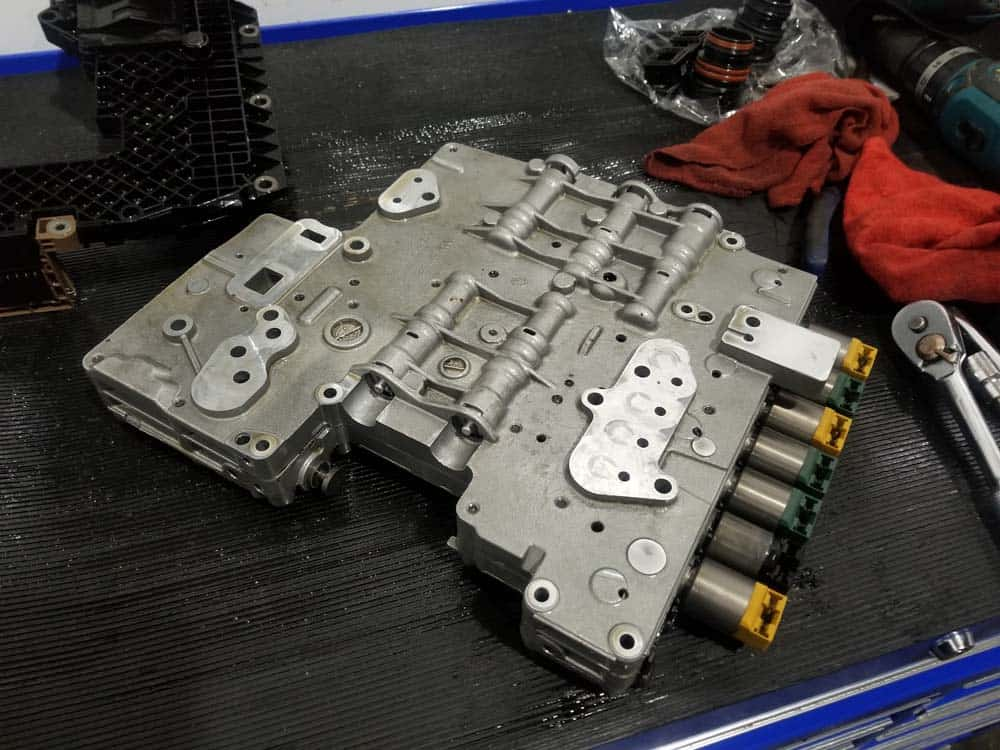 bmw transmission solenoid replacement - The valve body with the electronics module removed.