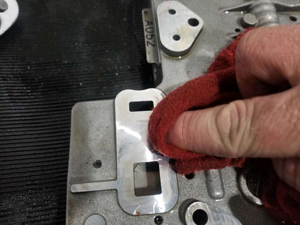 BMW mechatronics sealing sleeve and adapter replacement - Thoroughly wipe down valve body where adapter attaches