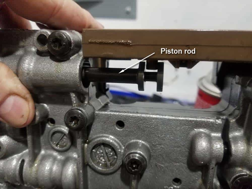Valve body piston rod