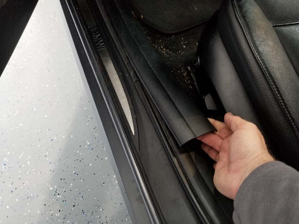 bmw footwell module - Remove the door entrance strip.
