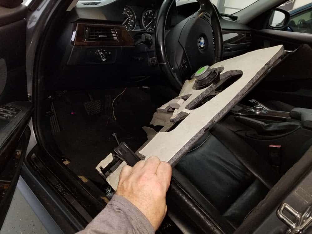 Remove the lower dash trim panel from the vehicle.