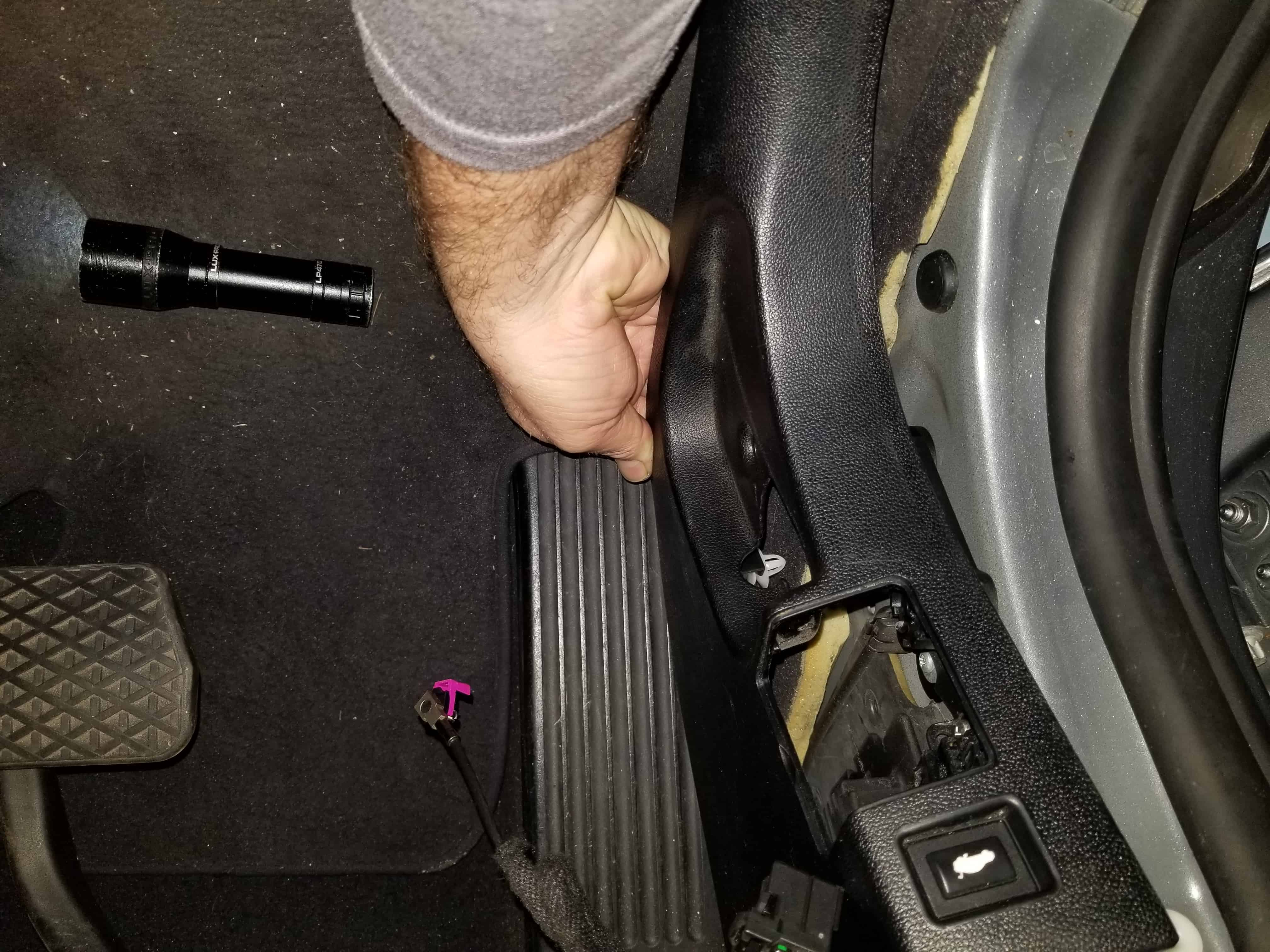bmw footwell module - Pull the lateral trim loose from body of vehicle.