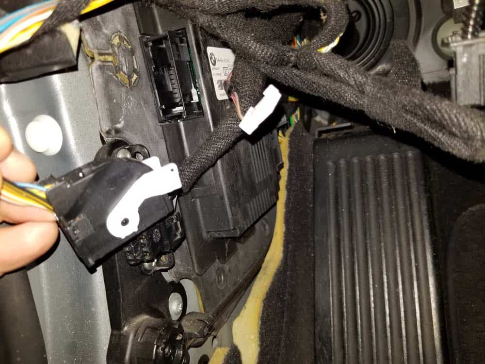 bmw footwell module - Pull the rear wiring harness free from the module