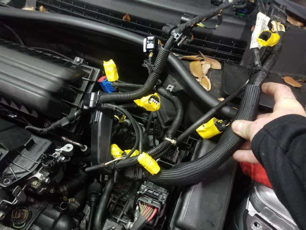 Mini R56 water pipe replacement - fold the wiring harness back to rear of engine compartment