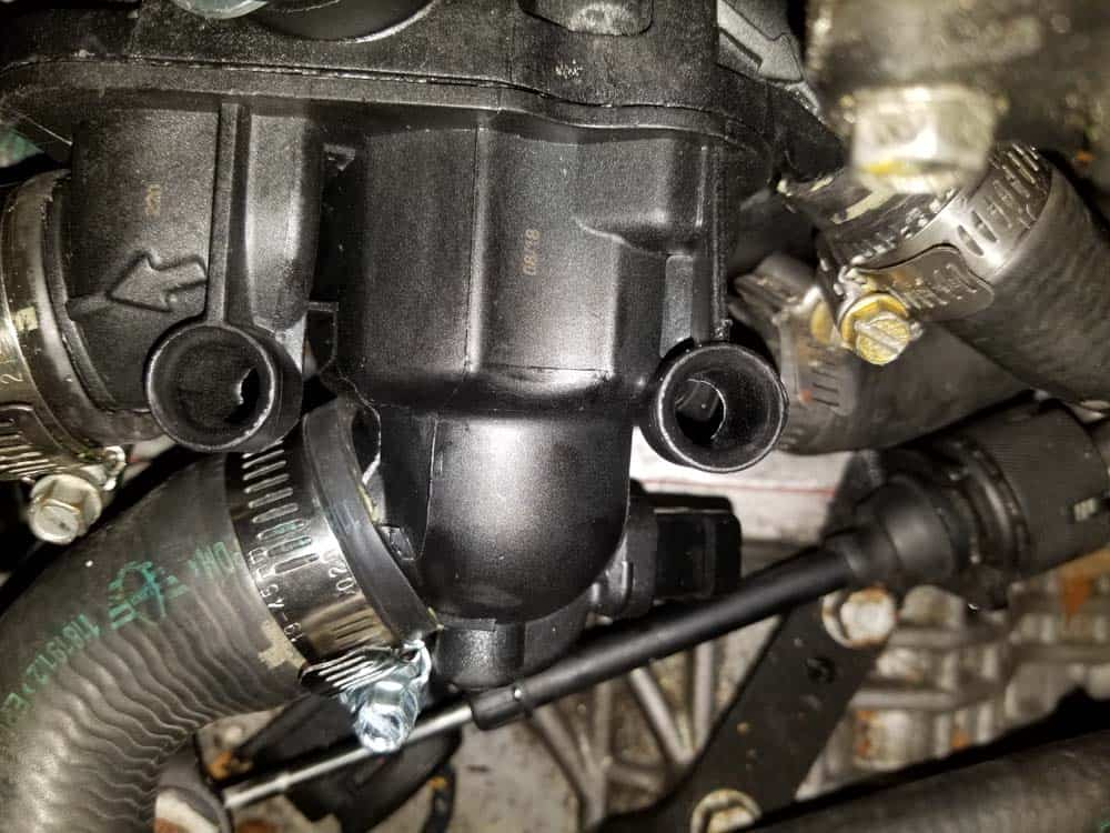 Mini R56 water pipe replacement - Thermostat mounting holes for wiring harness.