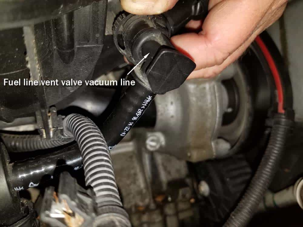 MINI R56 intake gasket repair - Disconnect the fuel line vent valve vacuum line from intake manifold.
