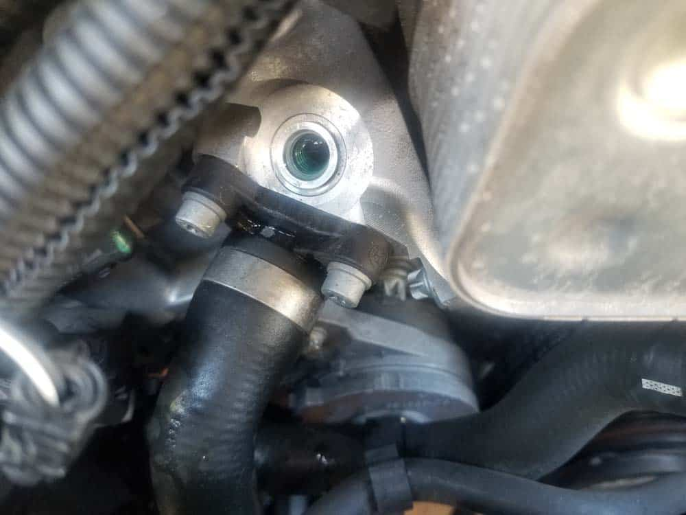 A small amount of coolant may drip out of the open hole when the sensor is removed, so have a rag ready