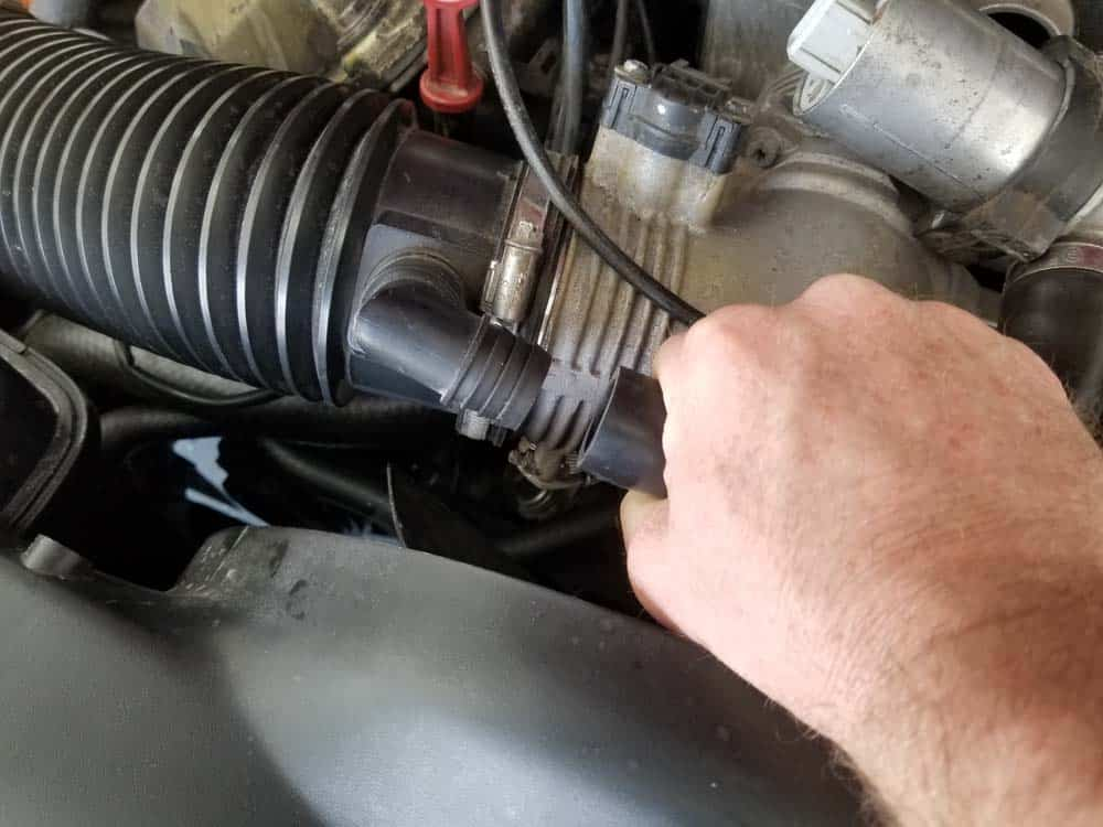 Disconnect the idle control valve vacuum hose from the intake boot.