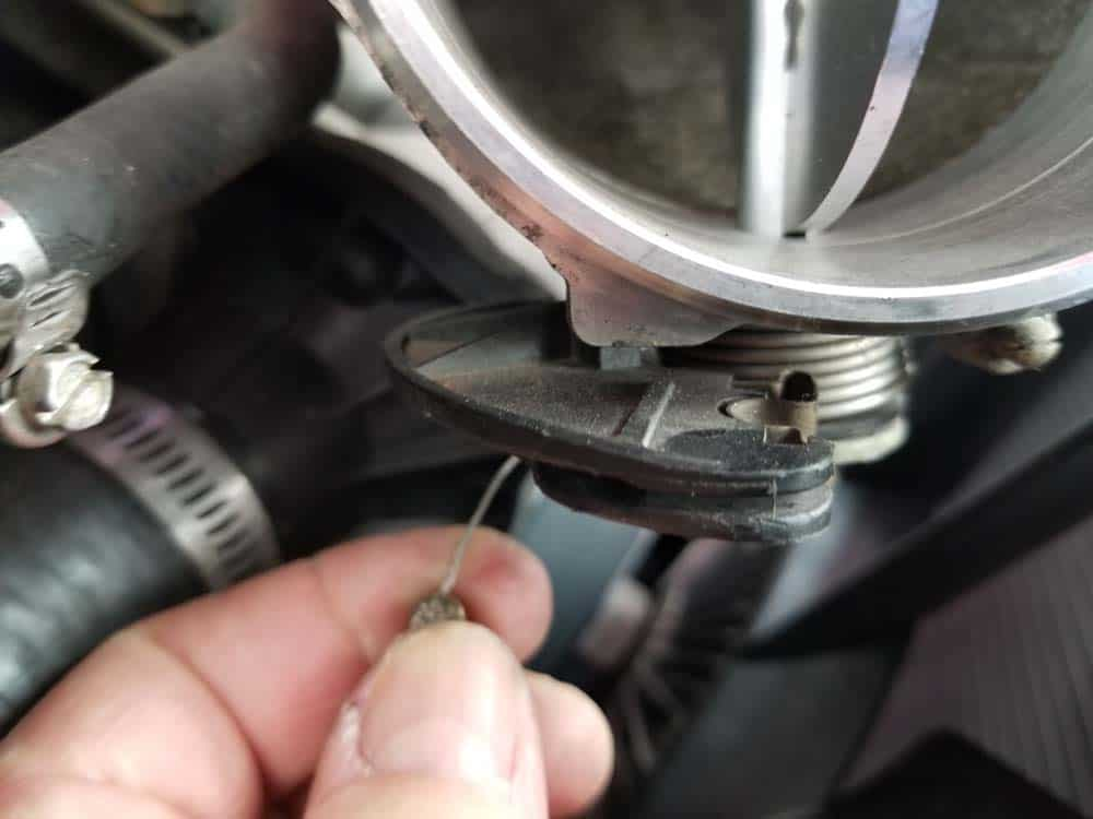 Remove the barrel fitting from the spring mechanism