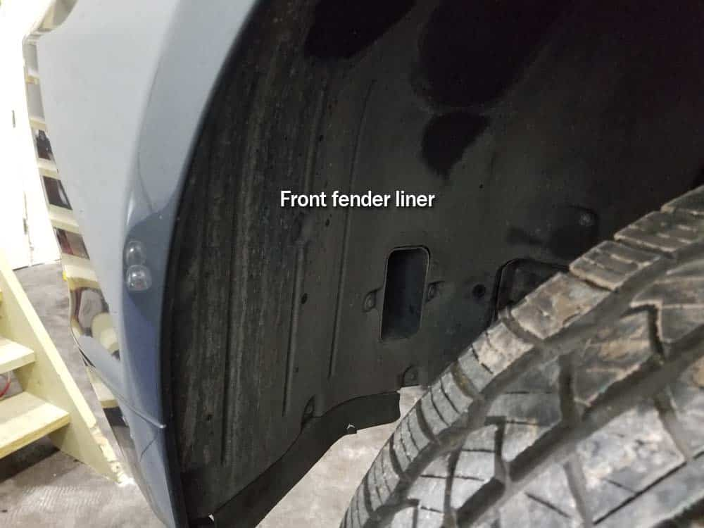 bmw e60 windshield washer pump replacement - the front fender liner is anchored by nine screws.