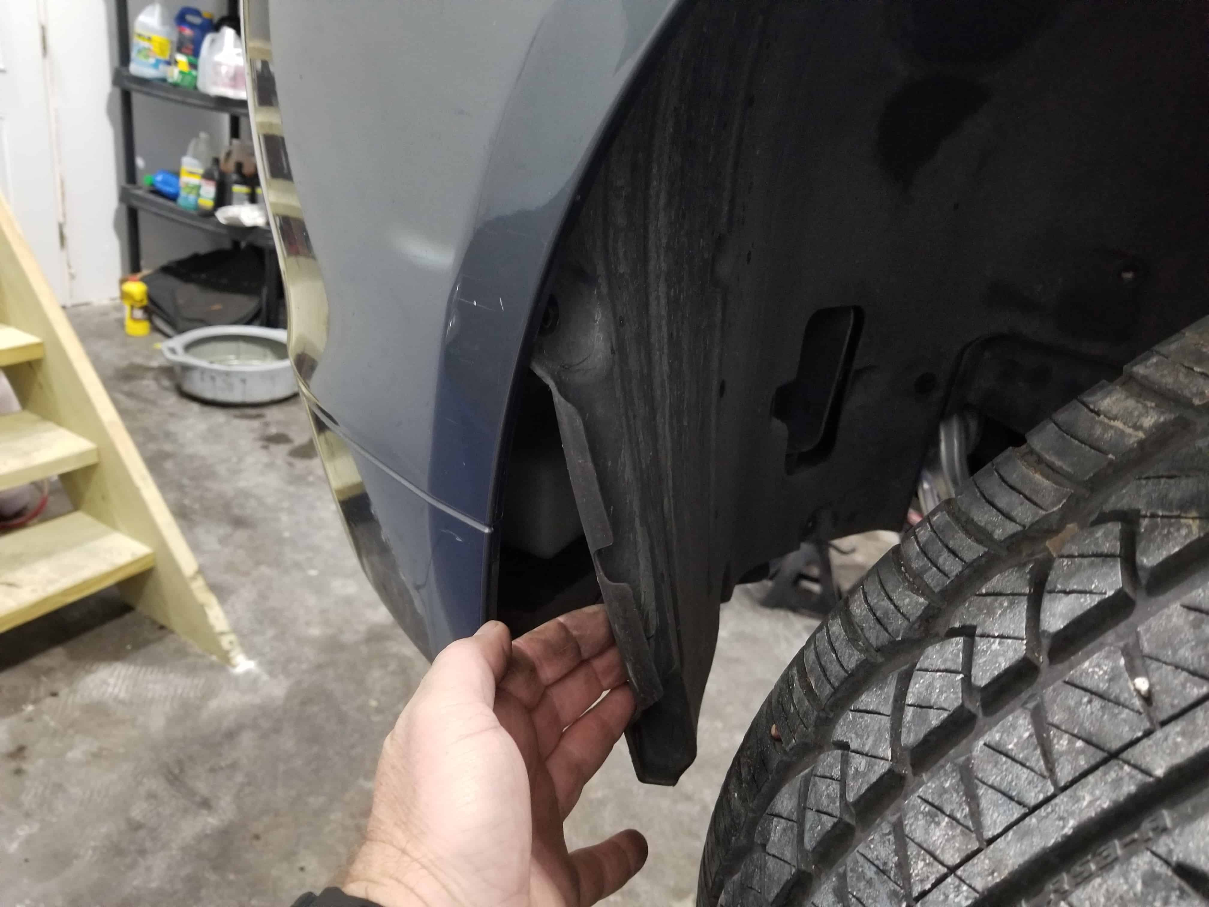 Pull the fender liner free from the car after the screws are removed.