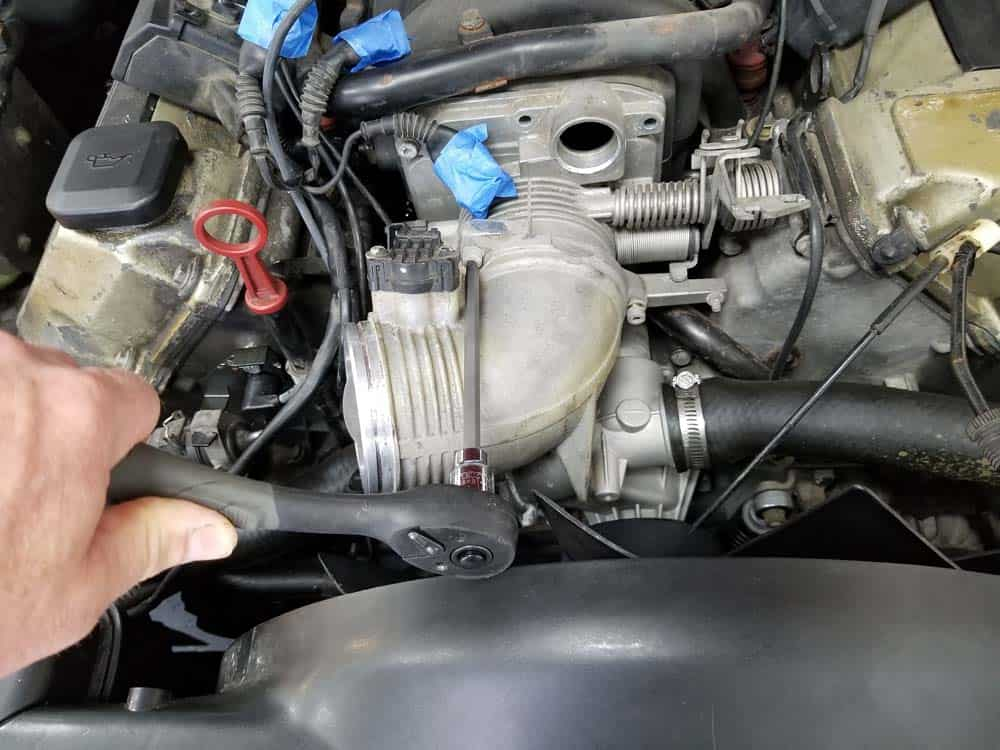 bmw M60 throttle body gasket replacement - Remove the three secondary throttle mounting bolts