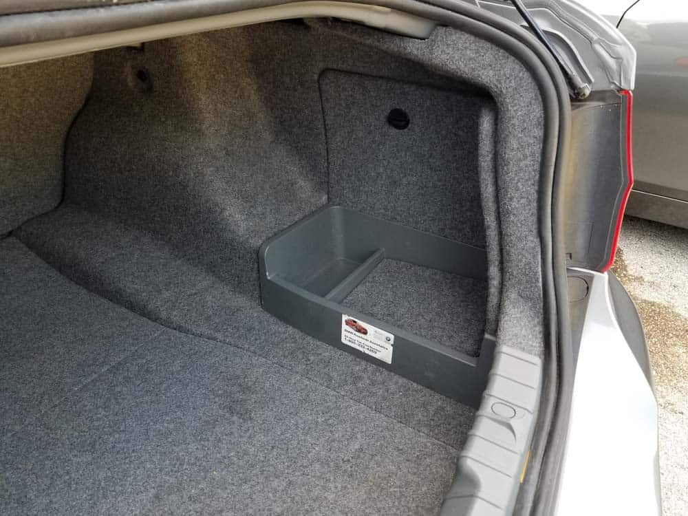 bmw e90 battery replacement - the battery is located in right side of the trunk