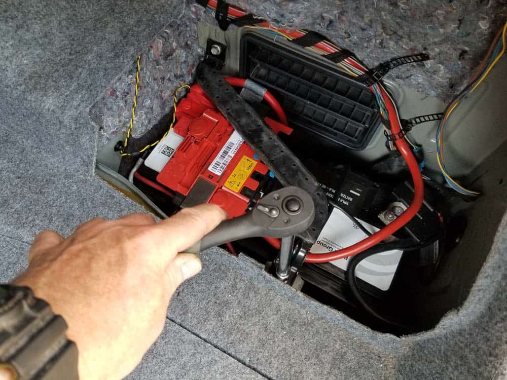 bmw e90 battery replacement - Remove the first 10mm bolt anchoring the roll over bracket