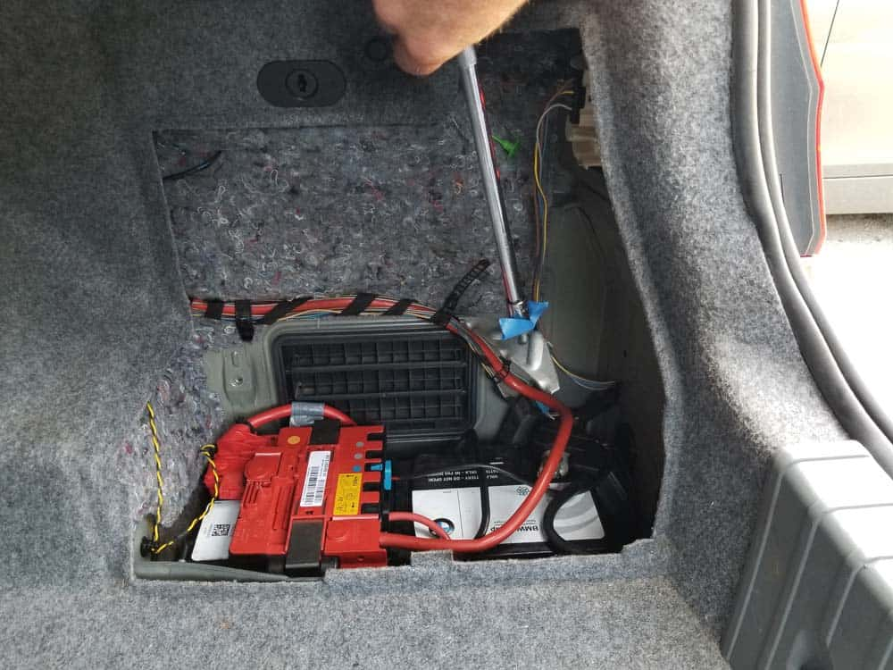 bmw e90 battery replacement - You can now lower the support bracket down into the battery compartment