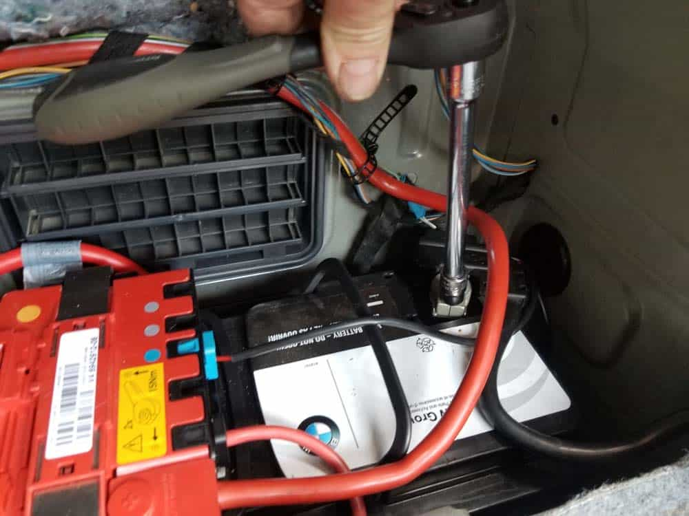 bmw e90 battery replacement - Use a 10mm socket wrench to remove the negative cable