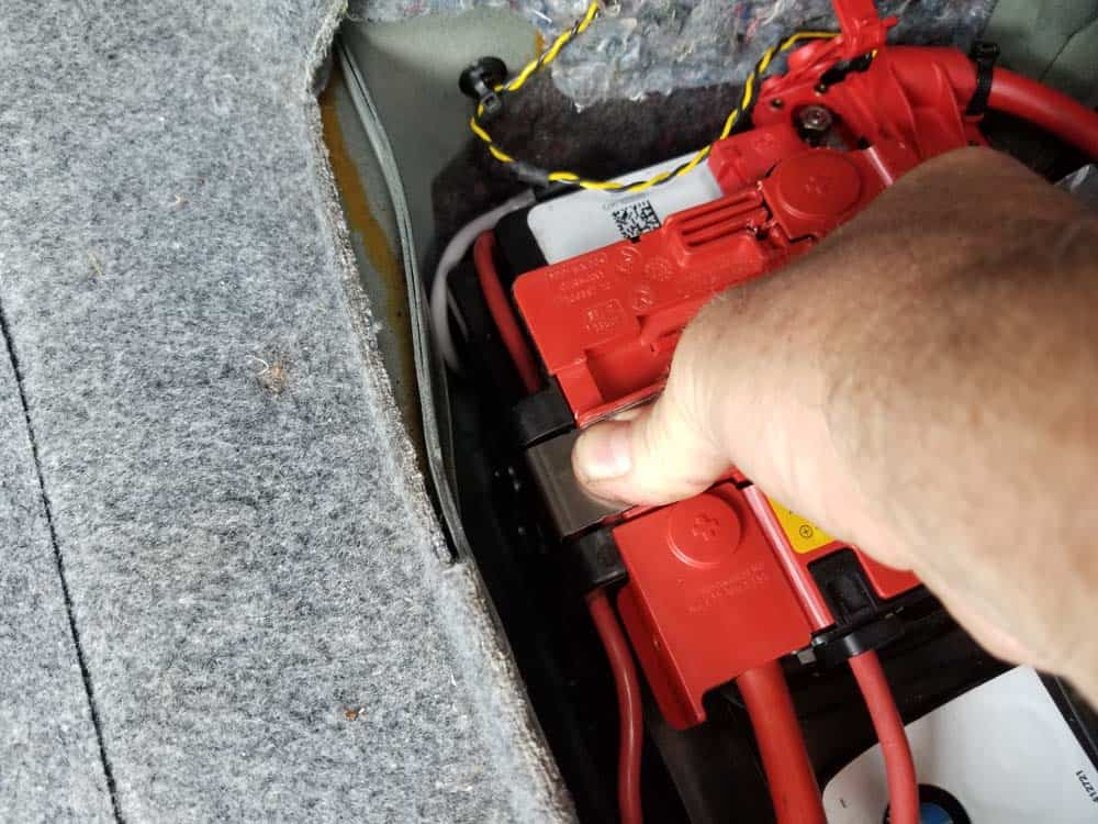 bmw e90 battery replacement - The left metal retaining clip on positive cable assembly