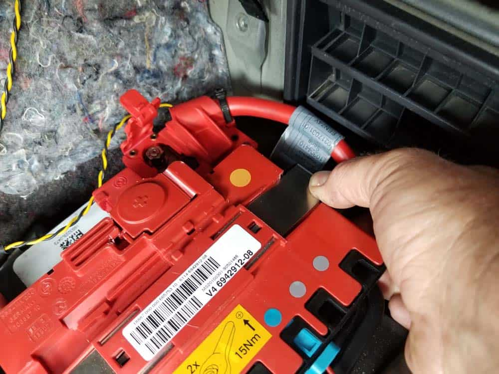 bmw e90 battery replacement - The right metal retaining clip on positive cable assembly