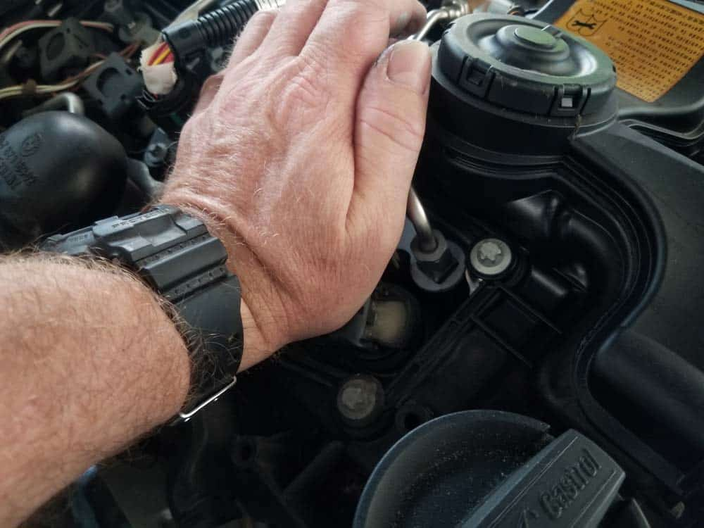 Use the palm of your hand to firmly push the ignition coil into place on the plug