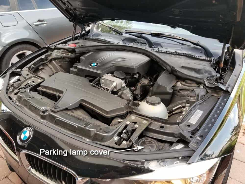 bmw f30 parking lamp replacement - The plastic access cover is on top of the headlight assembly