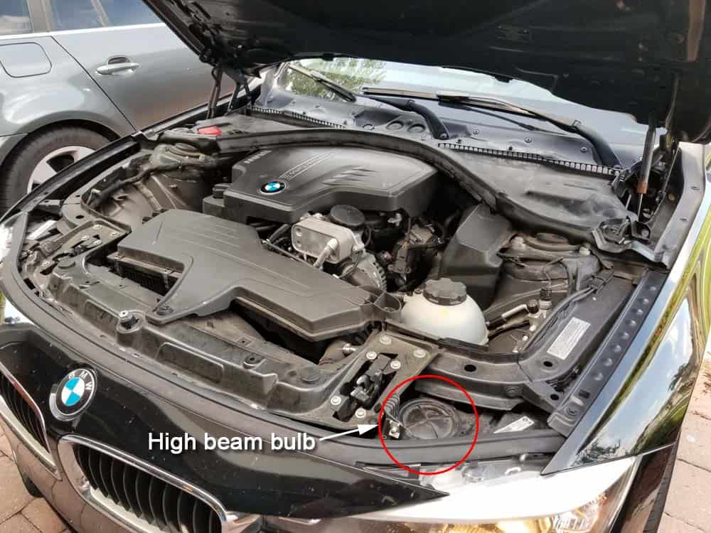 bmw f30 high beam bulb replacement - Bulb accessed from the top of the headlight assembly.