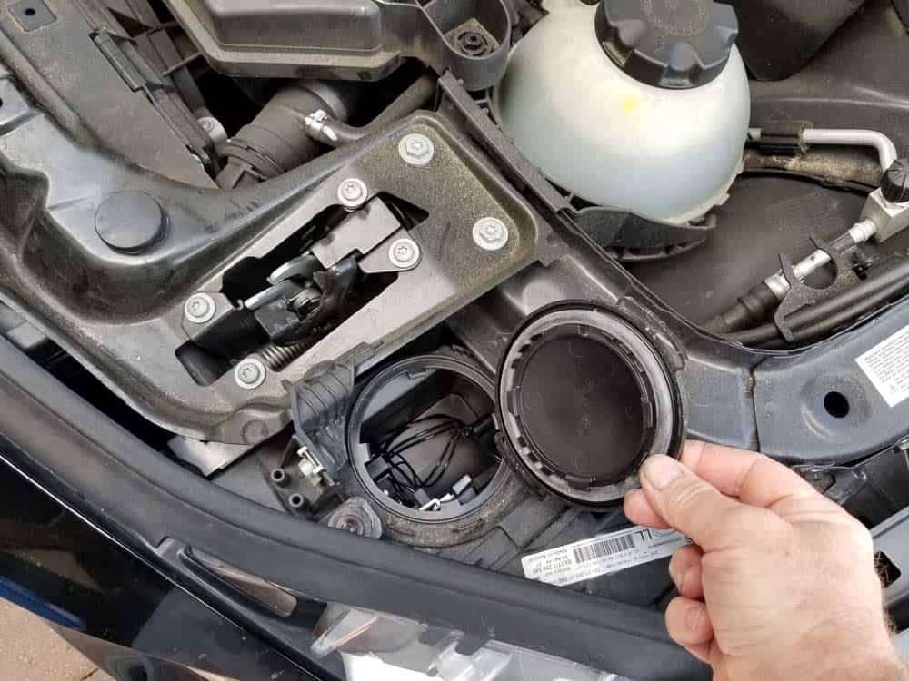 Remove the cover from the headlight assembly