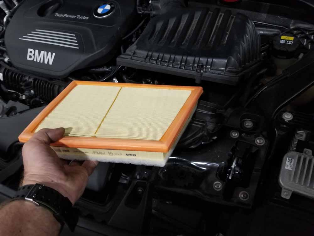 bmw x2 air filter replacement - Grasp the air filter and remove it