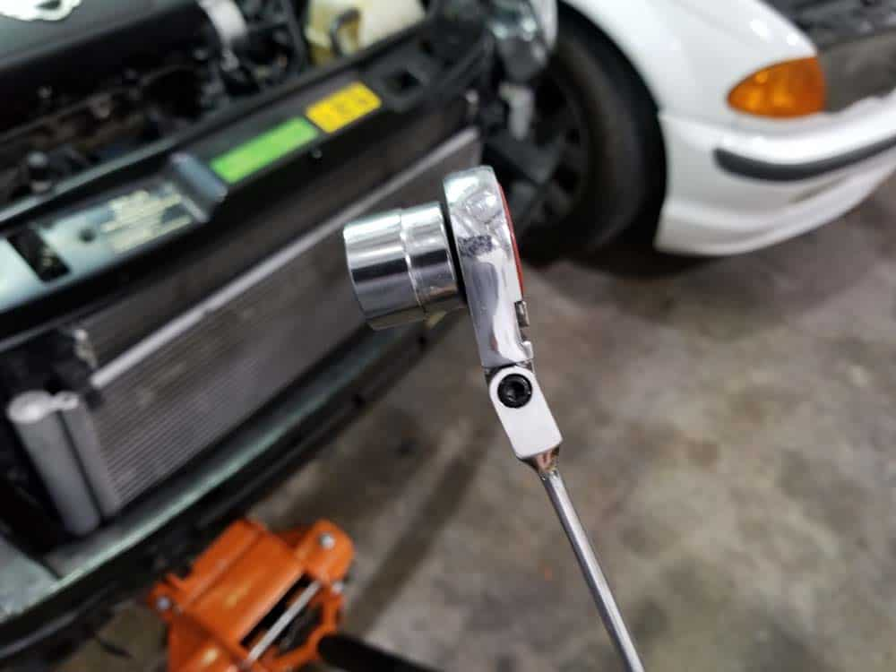 We use a low profile socket wrench when working on this repair (see our tool list)